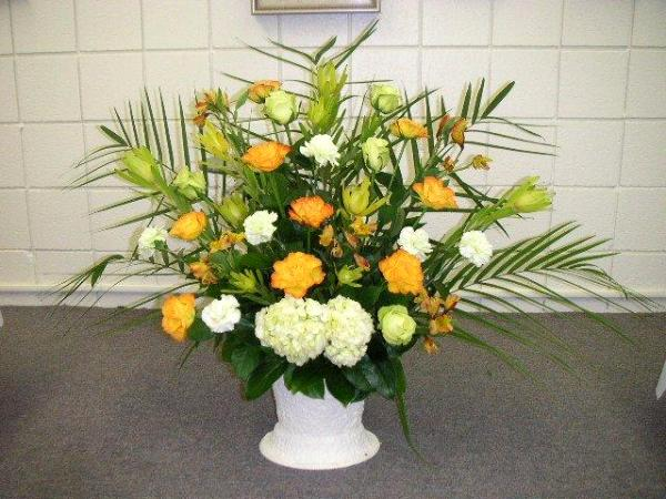 Entry floral arrangements displayed in a spacious foyer for Foyer flower arrangement