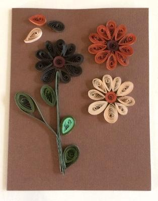 Brown flowers quilled greeting card
