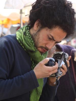 Man Examining  a Camera