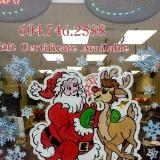 Santa with arm around deer