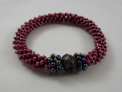 B-30 sparkling magenta crocheted rope bracelet