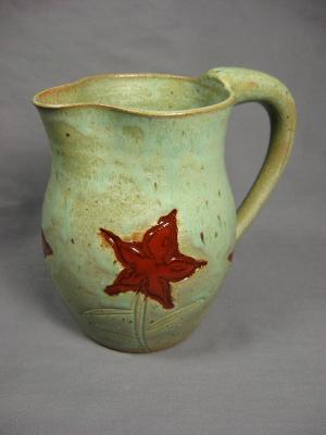 110621.F Pitcher with Flower Design