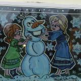 2 girls building a snowman