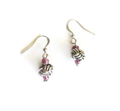 Purple celtic knot silver tone earrings