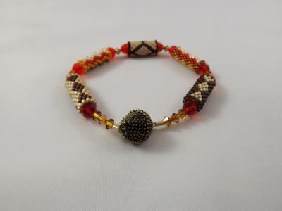 B-92 brown, orange, ecru, & amber beaded tube bracelet