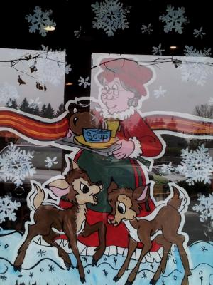 Mrs Claus serving with deer
