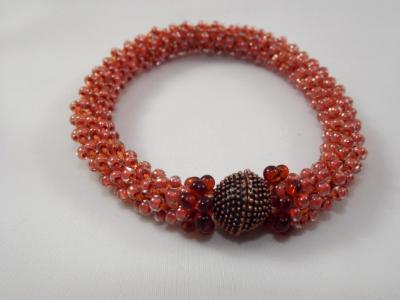 B-67 muted orange crocheted rope bracelet