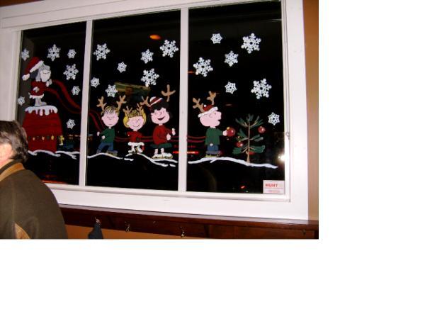Children skating Christmas window painting