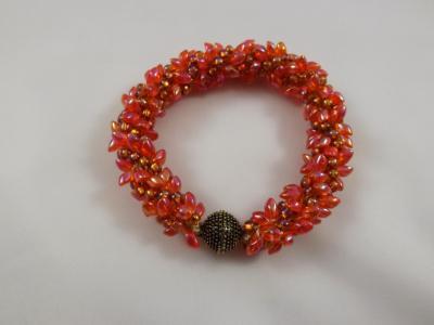 B-37 orange spikey bracelet