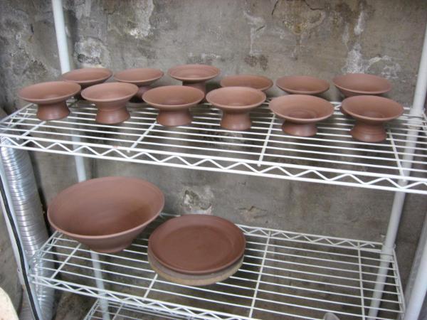 Asian vases drying on the rack