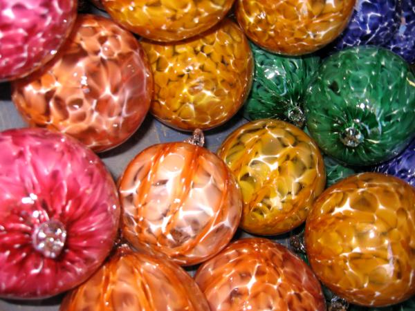 A Rainbow of colorful blown glass ornaments