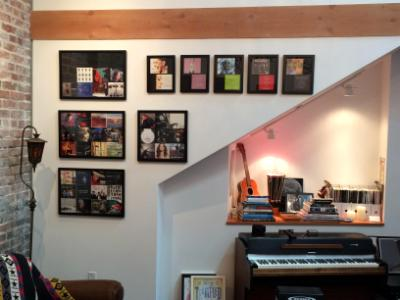 Wall of framed albums