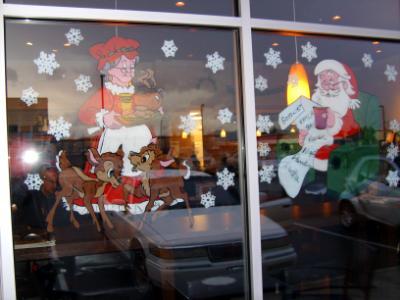 Mrs. Claus serving Santa