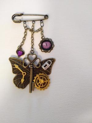 Bar pin , Key and charms with cat's eye