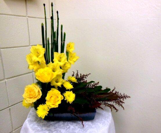 L shaped floral arrangement