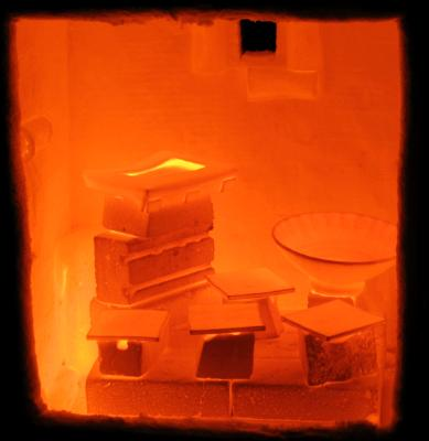 The inside of a just-opened kiln showing the pots glowing orange hot