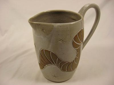 110731.A White Glazed Pitcher with Carved Design