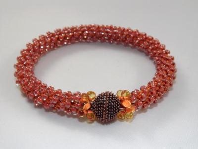 B-75 orange crocheted rope bracelet