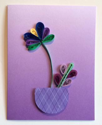 Purple flowers in flower pot