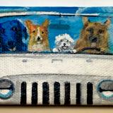 4 DOGS IN A JEEP
