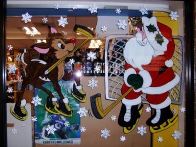 Santa & Rudolf playing hockey
