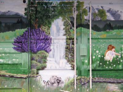 close-up waterfall and girl picking flowers finished